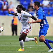Kenwyne Jones, Trinidad and Tobago, is challenged by Steve Purdy, El Salvador, (right),  during the El Salvador Vs Trinidad and Tobago CONCACAF Gold Cup group B football match at Red Bull Arena, Harrison, New Jersey. USA. 8th July 2013. Photo Tim Clayton