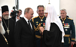 July 30, 2017 - Saint Petersburg, Russia - July 30, 2017. - Russia, Saint Petersburg. - Russian President Vladimir Putin visits St. Nicholas Naval Cathedral in Kronstadt on Russian Navy Day. Foreground right: Patriarch Kirill of Moscow and All Russia. Center: Defense Minister, Army General Sergey Shoigu. Background right: Deputy Defense Minister Nikolay Pankov. Background left: the cathedral beneficiary, Archimandrite Alexy. (Credit Image: © Russian Look via ZUMA Wire)