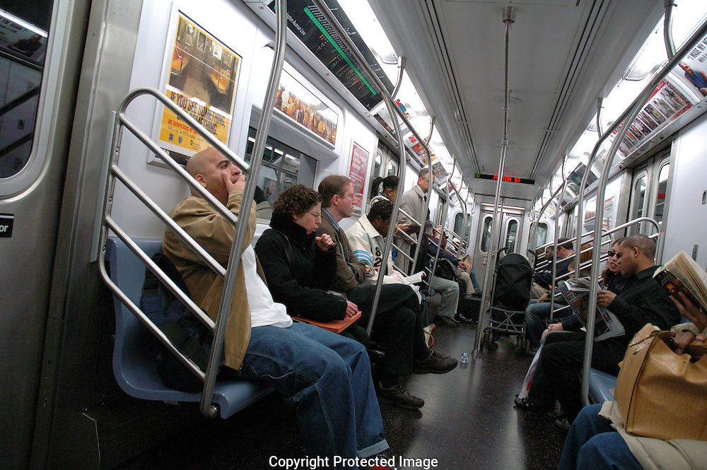 Passengers riding on New york City subway.
