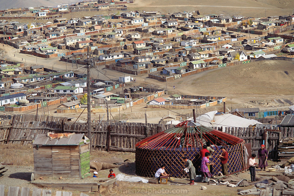 In late September, a family assembles a ger (round tent built from canvas, strong poles, and wool felt) in a squatter settlement on the hillsides of Ulaanbaatar, Mongolia. Material World Project.