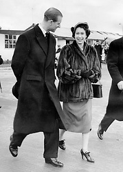 Jan. 31, 1952 - London, England, U.K. - The elder daughter of King George VI and Queen Elizabeth, ELIZABETH WINDSOR (named Elizabeth II) became Queen at the age of 25, and has reigned through more than five decades of enormous social change and development. PICTURED: QUEEN ELIZABETH II and PRINCE PHILIP Duke of Edinburgh walking the streets of London. (Credit Image: © Keystone Press Agency/Keystone USA via ZUMAPRESS.com)