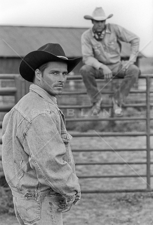 handsome cowboys outdoors on a working ranch