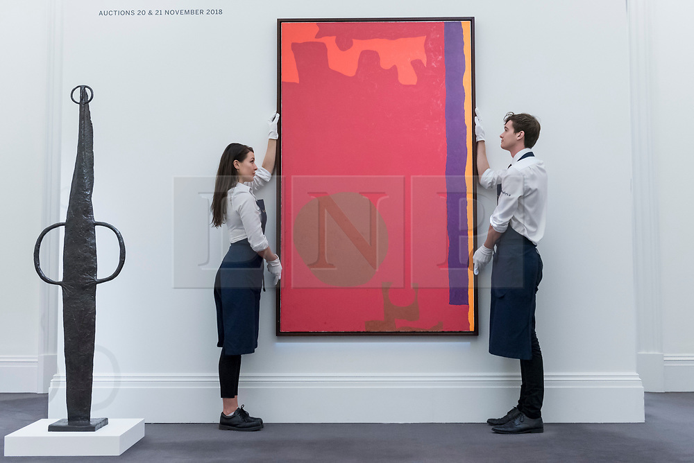 """© Licensed to London News Pictures. 16/11/2018. LONDON, UK. Technicians present """"Rumbold Vertical Two: Reds with Purple and Orange: March 1970"""", 1970, by Patrick Heron (Est. GBP120,000-180,000).  Preview of Sotheby's autumn sale of Modern & Post War British art.  Works from the British art scene of the past century will be offered for sale on 20 and 21 November 2018 at Sotheby's in London.  Photo credit: Stephen Chung/LNP"""