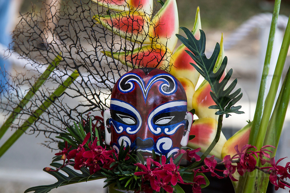 Decorative mask set amongst flowers, Ho Chi Minh City, Southeast Asia