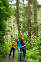Family hiking out on Cape Lookout Trail along the Oregon Coast Model released.