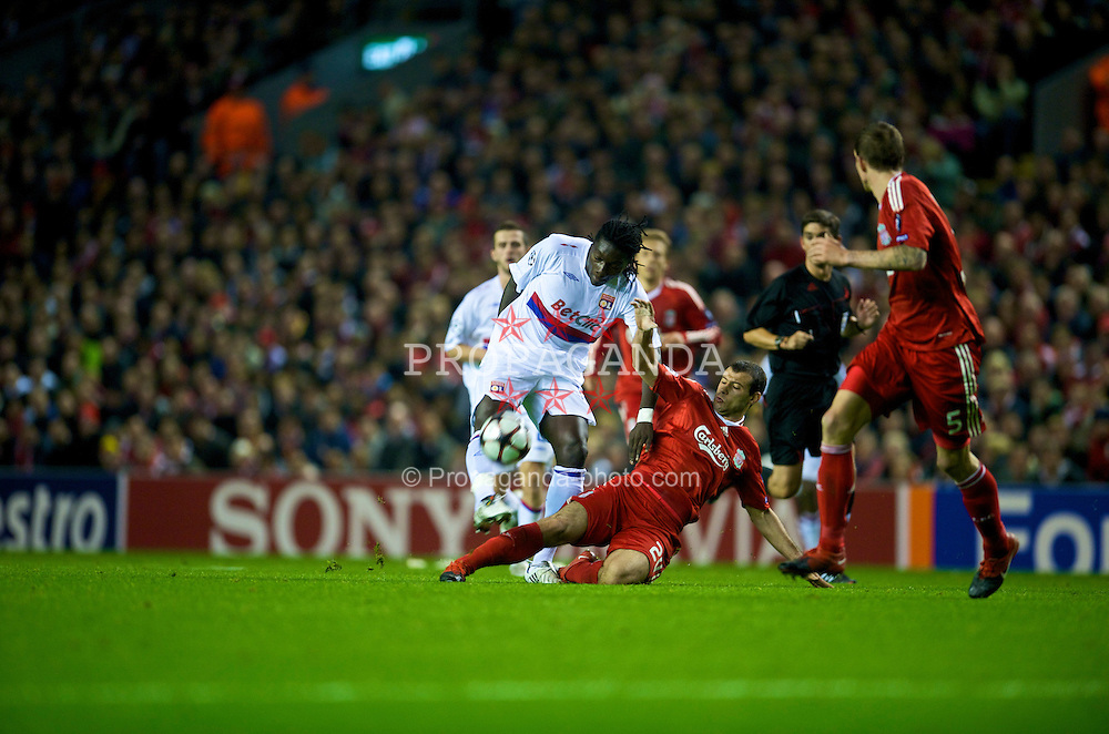 LIVERPOOL, ENGLAND - Tuesday, October 20, 2009: Liverpool's Javier Mascherano and Olympique Lyonnais's Bafetimbi Gomis during the UEFA Champions League Group E match at Anfield. (Pic by David Rawcliffe/Propaganda)
