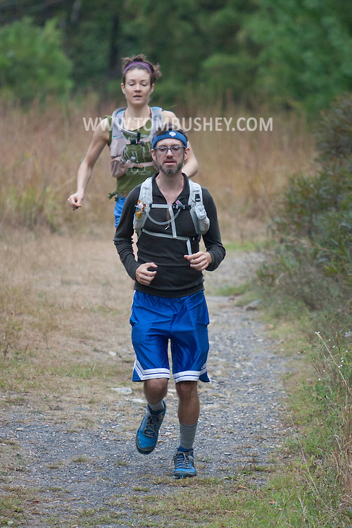 Kerhonkson, New York - Runners move through Minnewaska State Park Preserve during the Shawangunk Ridge Trail Run/Hike 20-mile race on Sept. 20, 2014.