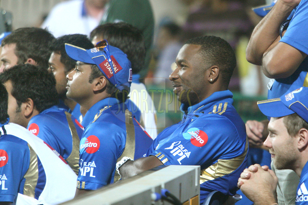 Mumbai Indians team watching their bastmen in play during the match 8 of the Indian Premier League ( IPL ) Season 4 between the Royal Challengers Bangalore and the Mumbai Indians held at the Chinnaswamy Stadium, Bangalore, Karnataka, India on the 12th April 2011..Photo by Vino John/BCCI/SPORTZPICS