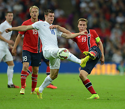 Norway's Ruben Jenssen tackles England's James Milner (Manchester City) - Photo mandatory by-line: Alex James/JMP - Mobile: 07966 386802 - 3/09/14 - SPORT - FOOTBALL - London - Wembley Stadium - England v Norway - International Friendly