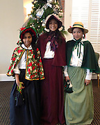 Grady MS seventh-grade students Shinelle Barretto, left, and Kate Hernandez, right, performed at Dickens on the Strand with the Girl Scouts Take Note choir. The girls also performed in costume at the Tidelanders barbershop choir concert at Houston Baptist University.<br /> To submit photos for inclusion in eNews, send them to hisdphotos@yahoo.com.