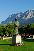 Flowers and outdoor candles around a statue of Dr. Franjo Tudman (Tudjman), first President of Croatia, with Biokovo National Park in background. Makarska, Croatia