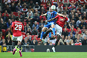 Rochdale's Ian Henderson heads the ball from Manchester United's Alex Tuanzebe during the EFL Cup match between Manchester United and Rochdale at Old Trafford, Manchester, England on 25 September 2019.