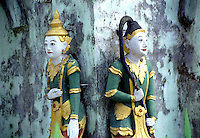 """BURMA (MYANMAR) Mandalay Division, Bagan, Myinkabar. 2006. These temple guardians watch over their small corner of the world. Even devout Burmese Buddhists also believe in """"nats,"""" or resident spirits."""