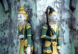 "BURMA (MYANMAR) Mandalay Division, Bagan, Myinkabar. 2006. These temple guardians watch over their small corner of the world. Even devout Burmese Buddhists also believe in ""nats,"" or resident spirits."
