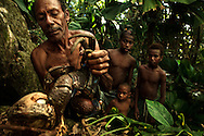 Ni Vanuatu man hunting coconut crab while the village children watch and learn. Rah Lava Island, Torba Province, Vanuatu