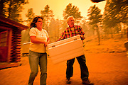 02 JUNE 2011 - ALPINE, AZ: Teresa and Jim Pinter (CQ) pack their car as they prepare to evacuate at the Wallow Fire near Alpine. High winds and temperatures complicated firefighters' efforts to get the blaze under control. Officials have issued a mandatory evacuation order and residents of the Alpine area had to leave by 8PM Thursday.   PHOTO BY JACK KURTZ