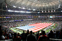 22 November 2007: The United States flag covers the field during the National Anthem before the Indianapolis Colts play the Atlanta Falcons before the Colts 31-13 victory over the Falcons at the Georgia Dome on Thanksgiving in Atlanta, Georgia.