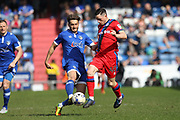Ollie Banks tackles Ian Henderson during the EFL Sky Bet League 1 match between Oldham Athletic and Rochdale at Boundary Park, Oldham, England on 22 April 2017. Photo by Daniel Youngs.