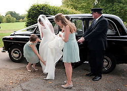 © London News Pictures. 14/09/2013.  The bride Suzanne Ashman arraigning at the church in a black cab, surrounded by bridesmaids. The wedding of Euan Blair, Son of former British Prime Minister Tony Blair,  to Suzanne Ashman at All Saints Parish Church in Wotton Underwood, Buckinghamshire. The wedding was attended by Former British Prime minister Tony Blair and his wife Cherie Blair. Photo credit: Ben Cawthra/LNP