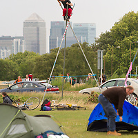 LONDON, ENGLAND - AUGUST 26:  Climate Camp protesters at  the final destination of Blackheath with the background of the city of london financial headquarters on August 26, 2009 in London, England.  ...Standard Licence feee's apply  to all image usage.Marco Secchi - Xianpix tel +44 (0) 7717 298571.http://www.marcosecchi.com