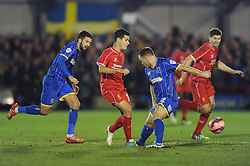 Liverpool's Philippe Coutinho avoids a tackle from Wimbledon's Barry Fuller - Photo mandatory by-line: Dougie Allward/JMP - Mobile: 07966 386802 - 05/01/2015 - SPORT - football - London - Cherry Red Records Stadium - AFC Wimbledon v Liverpool - FA Cup - Third Round