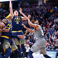05 April 2018: Denver Nuggets center Nikola Jokic (15) goes for the baby hook over Minnesota Timberwolves center Karl-Anthony Towns (32) during the Denver Nuggets 100-96 victory over the Minnesota Timberwolves, at the Pepsi Center, Denver, Colorado, USA.