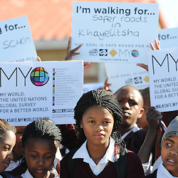 """CAPE TOWN, SOUTH AFRICA - Wednesday 17 July 2013, as part of Mandela Day learners from Sivile Primary School in Khayelitsha, an impoverished suburb of Cape Town, did a pedestrian walk to highlight the Red Cross War Memorial Children's Hospital's Childsafe campaign. Every year, approximately 1.3 million people are killed on the world's roads. Road crashes are the number one cause of death for children and young people. Worldwide, road deaths are overtaking the number of deaths from TB and malaria, and it has been projected that within 20 years, more people will die on the roads than of HIV/AIDS. As part of the Decade of Action for Road Safety 2011-2020 and in support of the Mandela's family initiative titled """"Long Short Walk"""", Childsafe South Africa has organized a walk Sivile Primary School . As this years' main theme (Global Road Safety Week in May) was focused on pedestrian safety the main aim was to raise awareness on issues pertaining to pedestrian safety. Therefore, Childsafe South Africa's three main objectives need to achieve the main aim, through the Long Short Walk are:<br /> To raise road safety awareness for all pedestrians.<br /> To encourage individuals and groups to participate in walks using safety materials and banners.<br /> To contribute to the Sustainable Development Goal on safe walking for all.<br /> Photo by Roger Sedres/ImageSA.net"""