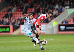 Jamey Osborne of Grimsby Town tackles James Rowe of Cheltenham Town  - Mandatory by-line: Nizaam Jones/JMP - 17/04/2017 - FOOTBALL - LCI Rail Stadium - Cheltenham, England - Cheltenham Town v Grimsby Town - Sky Bet League Two