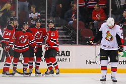 Dec 18, 2013; Newark, NJ, USA;  New Jersey Devils center Reid Boucher (15) celebrates his 1st NHL goal during the first period of their game against the Ottawa Senators at the Prudential Center.