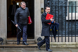 © Licensed to London News Pictures. 27/03/2018. London, UK. Scotland Secretary David Mundell (L) and Secretary of State for Wales Alun Cairns (R) on Downing Street after the weekly Cabinet meeting. Photo credit: Rob Pinney/LNP