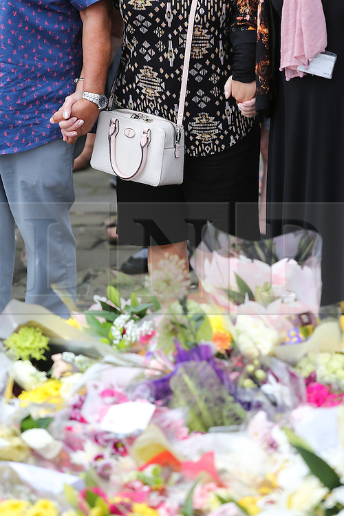 © Licensed to London News Pictures. 23/06/2016. Birstall, UK. Mourners hold hands in Birstall, West Yorkshire, a week to the day that Labour MP was shot and killed in the town. A one minutes silence was held at 13.50, the time that Jo was attacked last week outside her constituency surgery . Photo credit : Ian Hinchliffe/LNP