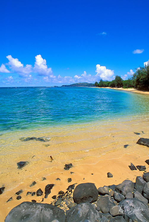 Blue Pacific waters and white sand at Anini Beach, North Shore, Island of Kauai, Hawaii USA