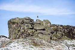 © Licensed to London News Pictures. 28/04/2016. Ilkley UK. Picture shows a man taking photographs on top of Ilkley moor as Yorkshire woke to a covering of snow this morning. Photo credit: Andrew McCaren/LNP