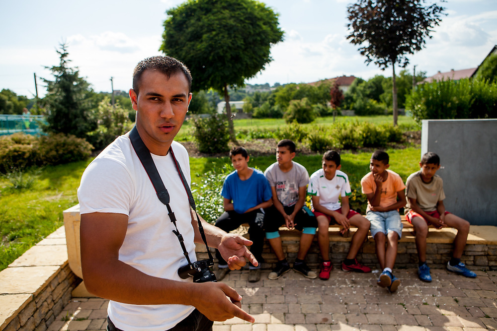 "Karol Horvath (21), who is a Roma himself and the founder of an independent group called ""Roma Film Maker"" with youngsters waiting to perform in a parkour video of the group. Karol lives in the city and has many family members living in the  settlement. The city of Moldava nad Bodvou has roughly 11200 inhabitants, about 1980 (18%) of them have Roma ethnicity and around 800 are living at the segregated settlement 'Budulovska Street' (2014)."