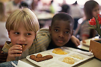 May 1998, Asheville, North Carolina, USA --- First Grade Students Eating Lunch --- Image by © Owen Franken/CORBIS