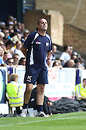 Picture by David Horn/Focus Images Ltd +44 7545 970036.18/08/2012.Accrington Stanley manager, Oaul Cook, looks on during the npower League 2 match at Roots Hall, Southend.