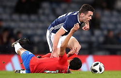 Scotland's John McGinn (right) and Costa Rica's Yeltsin Tejeda battle for the ball during the international friendly match at Hampden Park, Glasgow.
