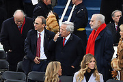 New England Patriots owner Robert Kraft, center, blows a kiss after arriving for the President Inaugural Ceremony on Capitol Hill January 20, 2017 in Washington, DC. Donald Trump became the 45th President of the United States in the ceremony. Standing with Kraft are Rudy Giuliani, left, son Patrick Kraft and Billionaire Carl Icahn, right.