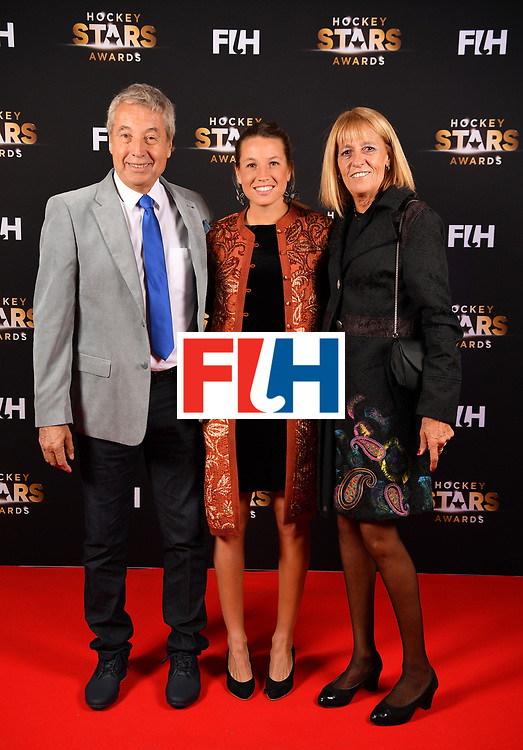 BERLIN, GERMANY - FEBRUARY 05:  Delfina Merino  of Argentina with her parents pose for a picture during the Hockey Star Awards night at Stilwerk on February 5, 2018 in Berlin, Germany.  (Photo by Stuart Franklin/Getty Images For FIH)