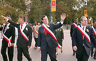 PHILADELPHIA - OCTOBER 1:  U.S. Senator Rick Santorum (R-Pa.) (C) walks near City Hall with former Philadelphia Solicitor Jonathan Seidel (L) during the Pulaski Day Parade Oct. 1, 2006 in Philadelphia, Pennsylvania. Santorum faces Democratic challenger Bob Casey Jr. in the November election. (Photo by William Thomas Cain/Getty Images)
