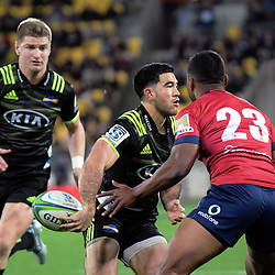 Hurricanes' Nehe Milner-Skudder passes to Hurricanes' Jordie Barrett during the Super Rugby match between the Hurricanes and Reds at Westpac Stadium in Wellington, New Zealand on Friday, 18 May 2018. Photo: Dave Lintott / lintottphoto.co.nz