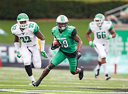 Oct 24, 2015; Huntington, WV, USA; Marshall Thundering Herd wide receiver Deandre Reaves catches a pass and looks for extra space against the North Texas Mean Green during the first quarter at Joan C. Edwards Stadium. Mandatory Credit: Ben Queen-USA TODAY Sports