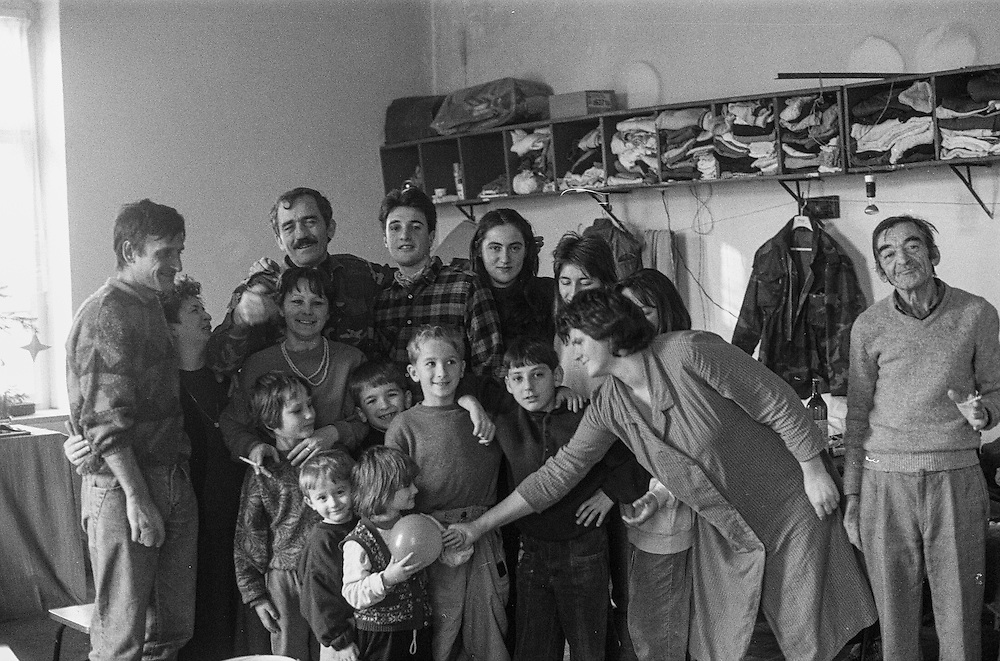 Group photo with refugees from Bosnia in the Varazdin refugee camp in Croatia in the winter of 1992. In the picture volunteer Gorka Espiau from Spain, 4th from the left in the back row.
