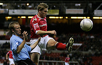 Photo: Paul Thomas.<br /> Nottingham Forest v Salisbury. The FA Cup. 12/12/2006.<br /> <br /> Forest's Kris Commons (R) clears the ball in front of Daniel Clay.