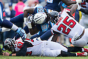 NASHVILLE, TN - OCTOBER 25:  Dexter McCluster #22 of the Tennessee Titans is tackled by William Moore #25 of the Atlanta Falcons at Nissan Stadium on October 25, 2015 in Nashville, Tennessee.  The Falcons defeated the Titans 10-7.  (Photo by Wesley Hitt/Getty Images) *** Local Caption *** Dexter McCluster; William Moore