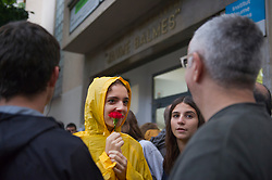 &copy; Licensed to London News Pictures. 01/10/2017. Barcelona, Spain.  <br /> <br /> A student is waiting early in the morning the opening of the Jaume Balmes&acute; institute, hanging a flower.<br /> <br /> Students, their parents, associations and neighbours have organized to carry out &quot;playful activities&quot; during the weekend and keep open the Jaume Balmes&acute; institute.<br />  <br /> Since early in the morning dozens of people wait at the college&acute;s door for the voting time under the rain.<br /> <br /> Mossos d&acute;Escuadra said they won&acute;t do nothing if that can destabilize social order.<br /> <br /> Catalonia is awaiting for today, October 1st, when the Spanish Region wants to vote in a self-determination referendum to get a independence.<br /> <br /> The Referendum&acute;s Law was passed on last September 6th at the Catalonian Parliament thanks to the votes of &quot;Junts pel Sí&quot; and &quot;CUP&quot;. Then it was suspended by the Spanish Constitutional Court, on next day.<br /> Carles Puigdemont, the President of the Government of&nbsp;Catalonia, said he would ignore that and he and his Government will continue with the Referendum.<br /> <br /> The Spanish Government has sent to Catalonia thousands of &quot;Guardia Civil&quot; and &quot;Policía Nacional&quot; officers (two of the Spanish forces and state security forces), to enforce the ruling of the Constitutional Court and avoid the voting process on next Sunday. They will work with the Mossos d&acute;Escuadra (the Autonomic police in Catalonia).<br /> <br /> To avoid the vote, the Spanish Government has prevented the opening of polling stations, some of which are schools.  <br /> <br /> Photo credit: Gustavo Valiente/LNP