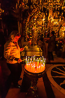 The 12th station of the Cross, the Altar of Crucifixion, Church of the Holy Sepulchure (also called the Church of the Resurrection), the Christian Quarter of the Old City, Jerusalem, Israel.