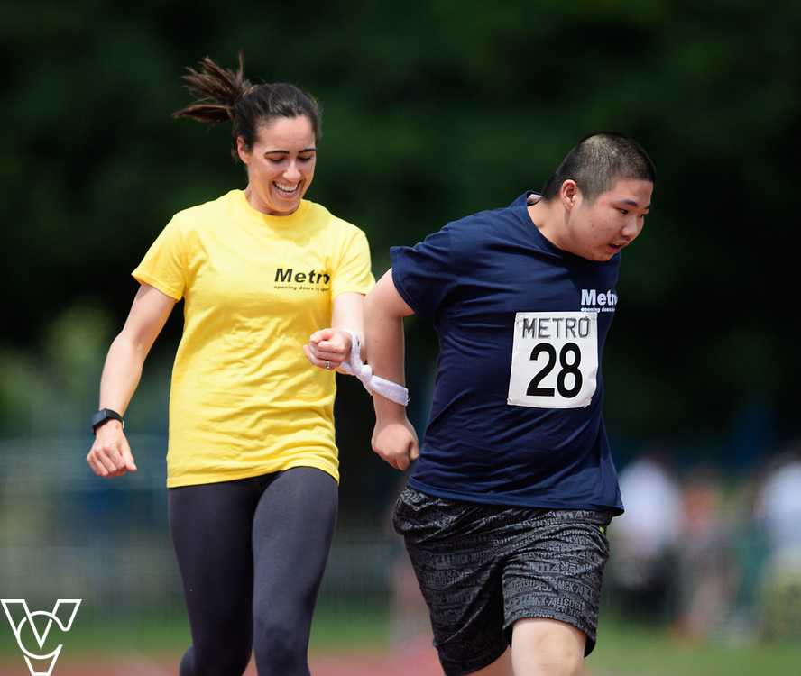 Metro Blind Sport's 2017 Athletics Open held at Mile End Stadium.  100m.  Junjie Xu with guide runner<br /> <br /> Picture: Chris Vaughan Photography for Metro Blind Sport<br /> Date: June 17, 2017