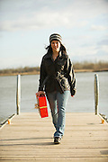 Young woman with a red gift box at Clay County Park on the banks of the Missouri River, Vermillion, SD.