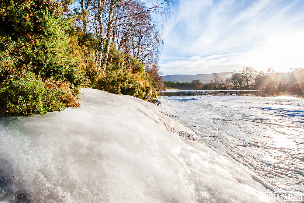 The banks of the River Dee are completley frozen, near Ballater, Royal Deeside, Scotland.